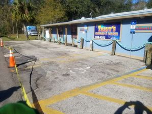 Before and after paving in Jacksonville, FL at Trents Seafood. (2)